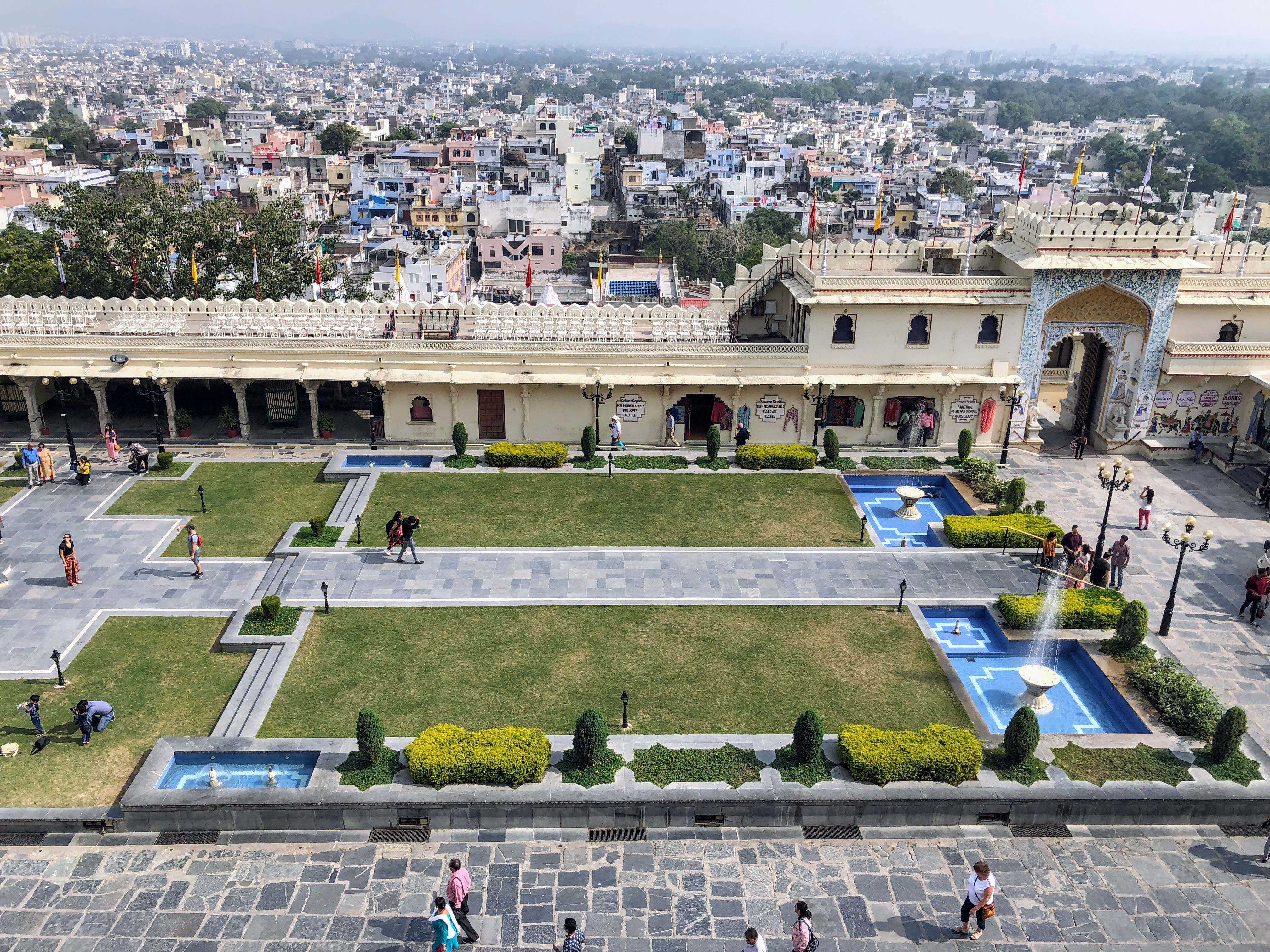 view over udaipur from the city palace, showing the gardens by the entrance and the city in the background